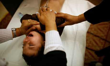 A Muslim boy undergoing circumcision