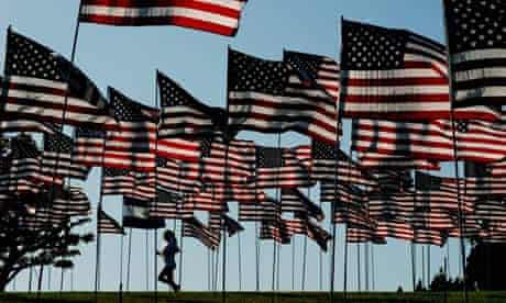 A woman jogs among flags