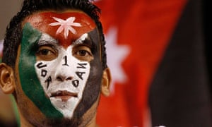 The painted face of a Jordanian fan