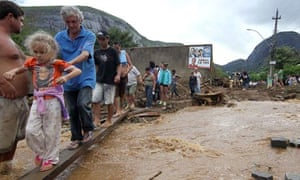 brazil mudslide survivors use plank to cross floods