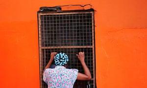Woman in hair curlers, Trinidad