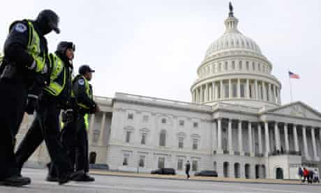 Police officers bundled up against the cold patrol the East Front of the U.S. Capitol in Washington