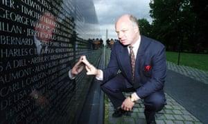 john wheeler touching the vietnam veterans memorial