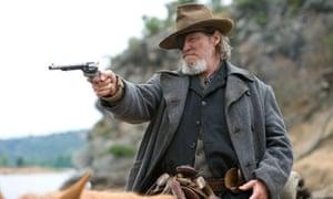 Jeff Bridges holding up a pistol in True Grit