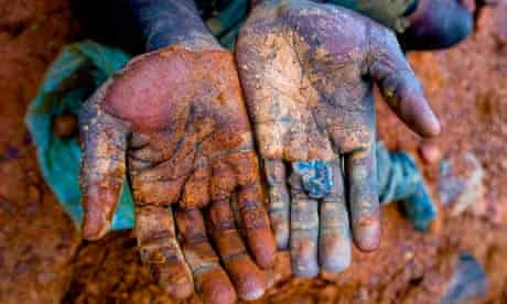 The hands of an African miner in Blood in the Mobile