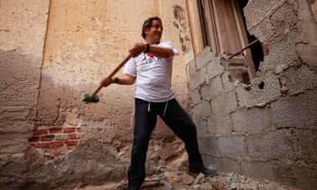 Libyan Jew David Gerbi breaking a wall