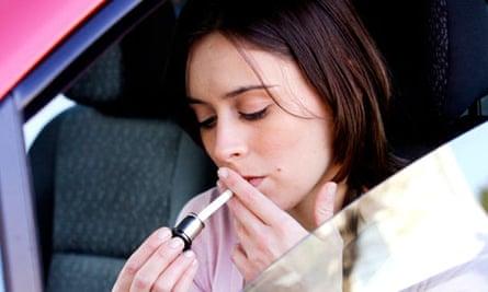 A women smoking inside a car