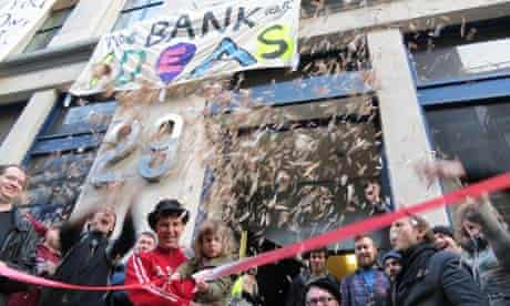 """Members of Occupy celebrate the """"reopening"""" of the UBS building as a discussion venue."""