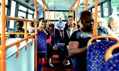 Londoners on the upper deck of a bus in the capital