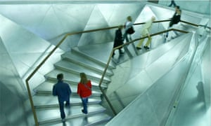 Visitors climb the stairs at the new Cai