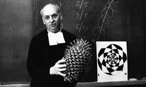Brother Brousseau uses a large pine cone to demonstrate the Fibonacci principle of mathematics