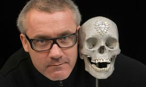 British artist Damien Hirst poses with 'For the love of God' - diamond skull
