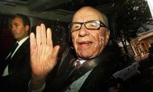 Rupert Murdoch leaves News International's London HQs, July 2011.