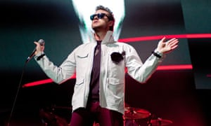 Kasabian frontman Tom Meighan onstage at the O2 Arena in London.