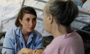 Health Care Assistant talks to a patient