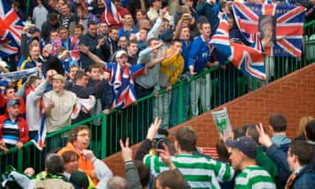 Rangers and Celtic fans at an Old Firm derby at Glasgow's Celtic Park stadium, 5 December 2002.