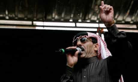 Singer Omar Souleyman of Syria gestures