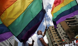 Men carrying rainbow flags take part in annual Gay Pride Parade in Caracas