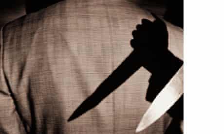 Hand holding kitchen knife