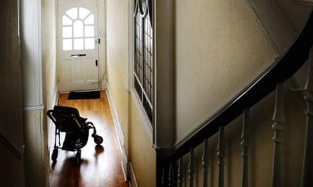 A buggy or pram in a hallway