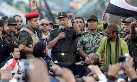 An Egyptian army commander, Hassan al-Roweny, addresses protesters