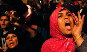 An opposition supporter shouts in their stronghold of Tahrir Square, in Cairo