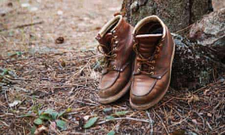 Pair of boots at tree trunk
