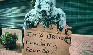 Alleged drug dealer tarred and feathered