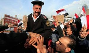 An Egyptian policeman cries