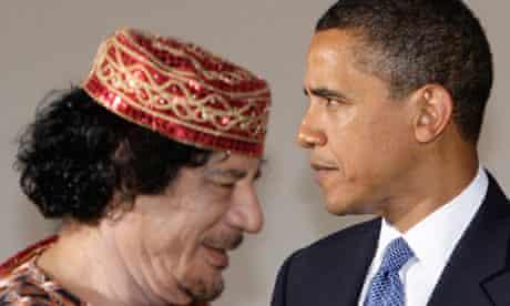 File photo of Obama and Gaddafi in L'Aquila