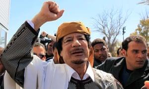 Libyan leader Muammar Gaddafi waves in Tripoli before making a speech