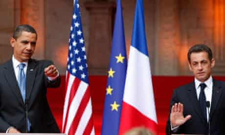 Nicolas Sarkozy and Barack Obama with French, EU and US flags