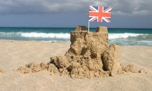 Beach scene with Union flag on sandcastle