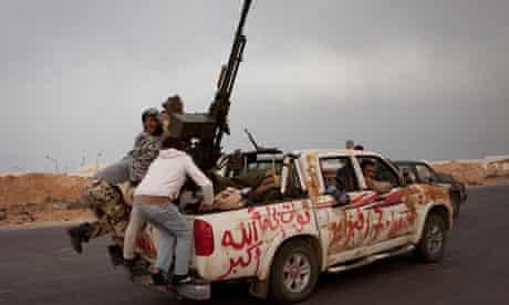 Libya rebels with guns on a truck