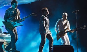 u2's Bono, the Ddge and bassist Adam Clayton on stage