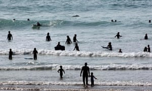 Swimmers in the sea in Newquay, UK