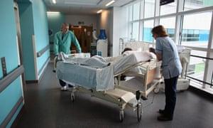 Staff look after patient on trolly in Queen Elizabeth Hospital