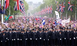 Police and crowds on mall royal wedding day