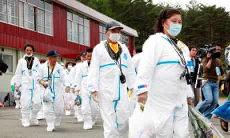 japan exclusion zone residents in protective clothing