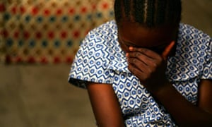 Congo rape victim shields her face