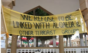 Derna banner reading 'we refuse to be linked with al-qaeda'