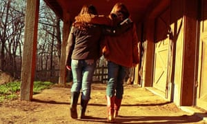 Best friends walking with arms around each other