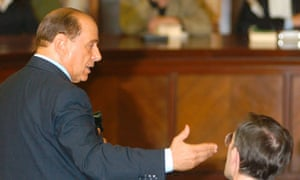 Italian Premier Silvio Berlusconi addresses a court