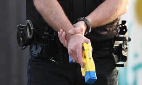 Policeman holding Taser stun gun