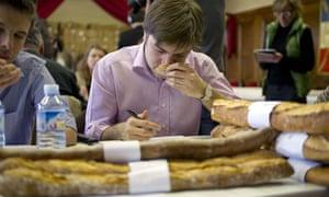 Baguette competition judge smells sample