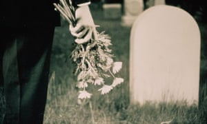 Man with Flowers in Cemetery