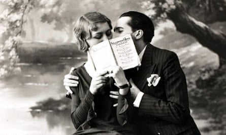 romantic couple kissing behind an open book