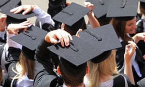 """Graduates with their mortarboard hats"""