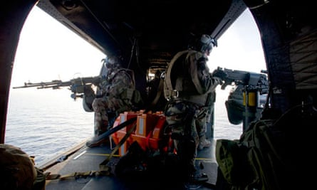 Door gunners aboard a French military attack helicopter