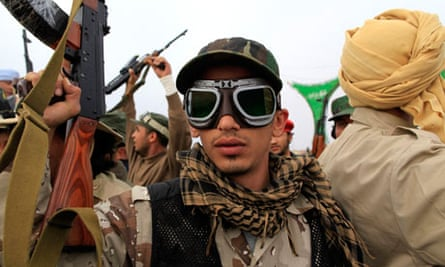 A Libyan government soldier poses for the camera
